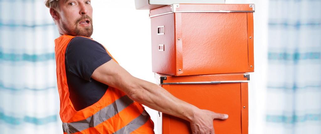 Manual Handling Training. Man lifting boxes.
